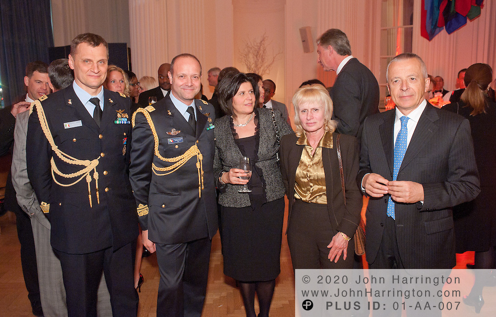 Col. Flavio Danielis (left), of the Italian Air Force and Maj, Gen Salvestroni (second from left), the Defense Attache for Italy, alongside other guests enjoy a holiday event held by Finmeccanica at the Organization for American States in Washington, DC on December 8th, 2010.