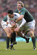 © SPORTZPICS /SECONDS LEFT IMAGES 2010 - Rugby Union - Investec  Internationals  - England v South Africa - 27/11/10 - England's Shontayne Hape lifted in the tackle by h Africa's Jean de Villiers 12 and Francois Steyn  - at Twickenham Stadium UK -  All rights reserved