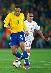 Gilberto Silva of Brazil vs Humberto Suazo of Chile during the 2010 FIFA World Cup South Africa Round of Sixteen match between Brazil and Chile at Ellis Park Stadium on June 28, 2010 in Johannesburg, South Africa. Brazil defeated Mexico 3-0 and qualified for quarterfinals.  (Photo by Vid Ponikvar / Sportida)