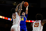 South Dakota State Jackrabbits guard Alex Arians (34) shoots the ball over Southern California Trojans forward Onyeka Okongwu (21) during the first half of an NCAA basketball game, Tuesday, Nov. 12, 2019, in Los Angeles. USC defeated South Dakota State 84-66. (Brandon Sloter/Image of Sport)