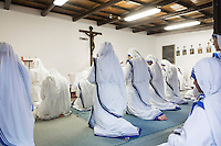 ROME, ITALY - 27 AUGUST 2016: Sisters of the Missionaries of Charity, the religious congregation founded by Mother Teresa in 1950, pray during the morning mass at the Mother House in Rome, Italy, on August 27th 2016.<br /> <br /> Mother Teresa, also known as Blessed Teresa of Calcutta, was an Albanian Roman Catholic nun and missionary. She founded the Missionaries of Charity, a Roman Catholic religious congregation, whose members must adhere to the vows of chastity, poverty, and obedience, as well as the vow to give wholehearted free service to the poorest of the poor. Shortly after she died in 1997, Pope John Paul II waived the usual five-year waiting period and allowed the opening of the process to declare her sainthood. She was beatified in 2003. A second miracle was credited to her intercession by Pope Francis, in December 2015, paving the way for her to be recognised as a saint by the Roman Catholic Church. Her canonisation is scheduled for September 4th 2016, a day before the 19th anniversary of her death.