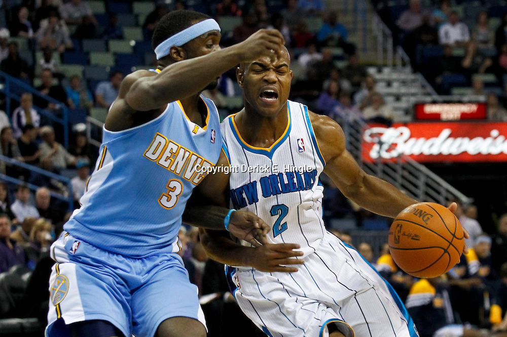 January 6, 2012; New Orleans, LA, USA; New Orleans Hornets point guard Jarrett Jack (2) drives past Denver Nuggets point guard Ty Lawson (3) during the first quarter of a game at the New Orleans Arena.   Mandatory Credit: Derick E. Hingle-US PRESSWIRE