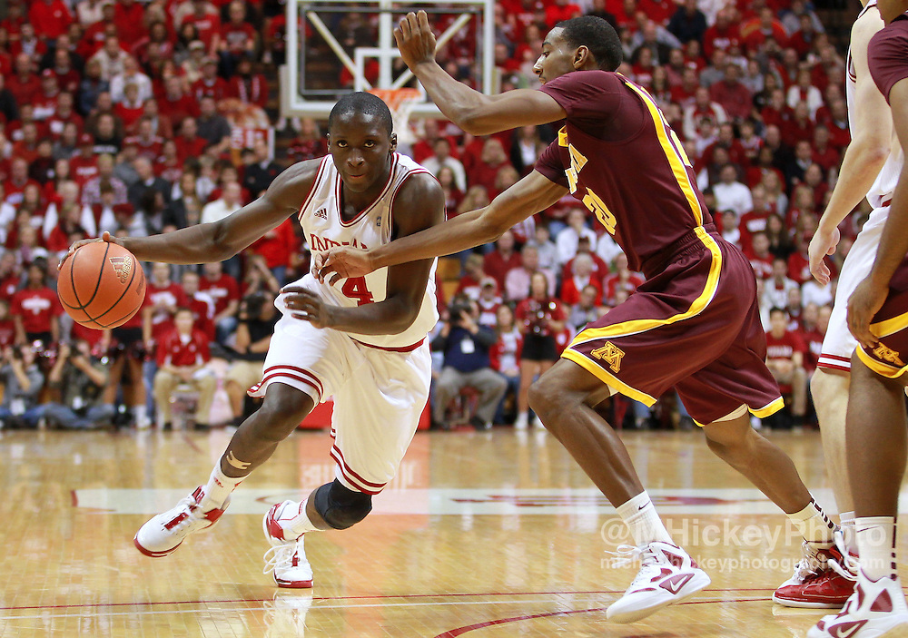 Jan. 12, 2012; Bloomington, IN, USA; Indiana Hoosiers guard Victor Oladipo (4) dribbles the ball around Minnesota Golden Gophers guard Austin Hollins (20) at Assembly Hall. Minnesota defeated Indiana 77-74. Mandatory credit: Michael Hickey-US PRESSWIRE