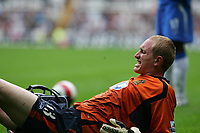Photo: Andrew Unwin.<br />Newcastle United v Wigan Athletic. The Barclays Premiership. 19/08/2006.<br />Wigan's Chris Kirkland feels the pain after a collision with Newcastle's Shola Ameobi.