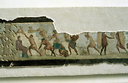 Roman workers building a wall; slaves watched by a taskmaster. Fragment of a wall painting