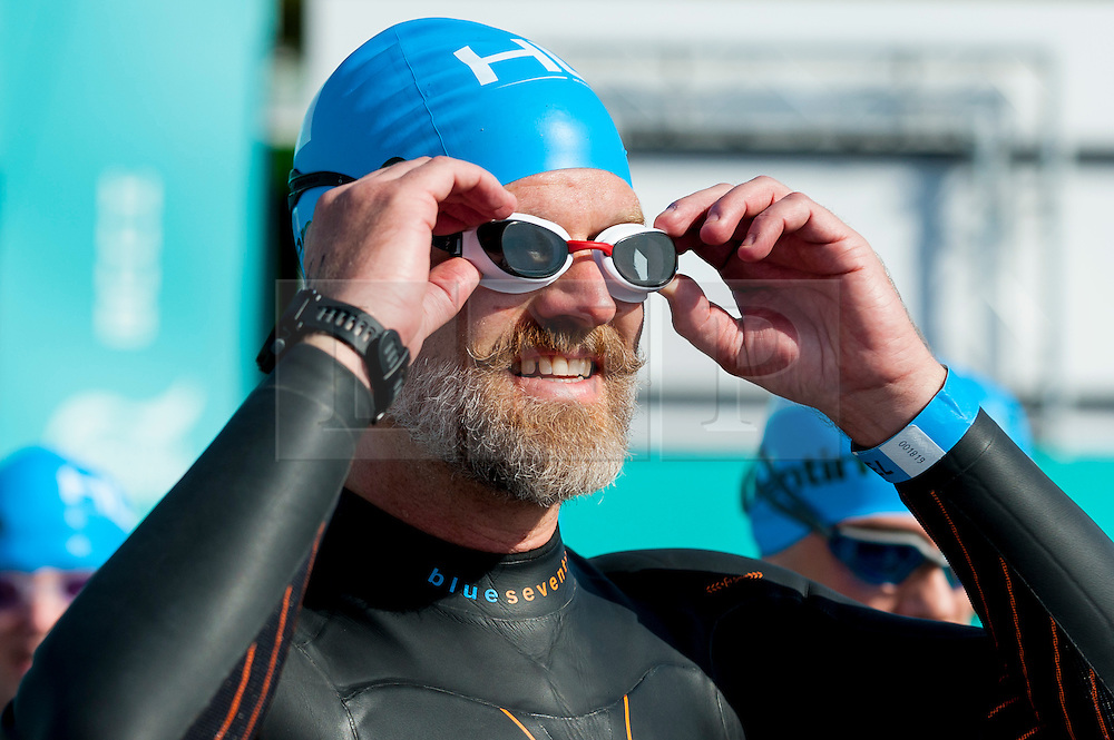 © Licensed to London News Pictures. 24/09/2016. London, UK. A participant at the start of the first ever Swim Serpentine, held in the famous lake in Hyde Park.  Raising thousands for charity and with water temperatures of 18C, swimmers navigate the one mile clockwise route around the lake.  The two-day open water swimming festival includes the British Open Water Swimming Championships on Sunday. Photo credit : Stephen Chung/LNP