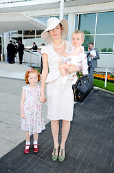 CAMILLA RUTHERFORD and her daughters MAUDE and NANCY at the Investec Ladies Day at Epsom Racecourse, Surrey on 4th June 2010.