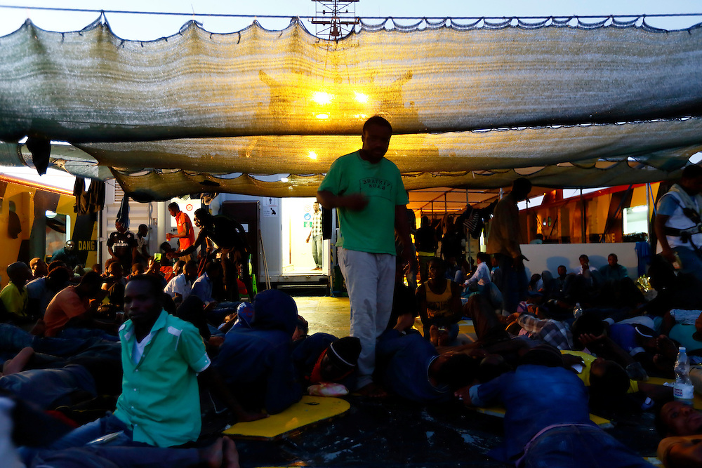 Migrants rest on the deck of the Medecins san Frontiere (MSF) ship Bourbon Argos off the coast of Libya August 7, 2015.  Some 241 mostly West African migrants on the ship are expected to arrive on the Italian island of Sicily on Sunday, according to MSF.<br /> REUTERS/Darrin Zammit Lupi <br /> MALTA OUT. NO COMMERCIAL OR EDITORIAL SALES IN MALTA