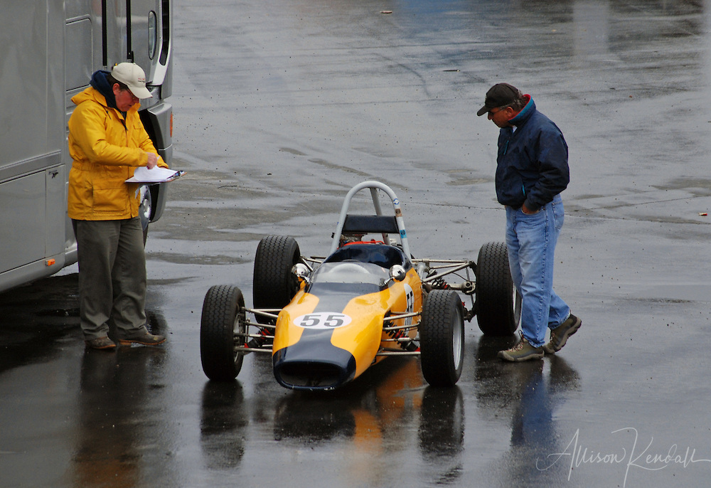 A rainy day at the track, race officials look over a vehicle during HMSA events at Laguna Seca