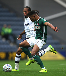 Daniel Johnson of Preston North End (L) and Ollie Watkins of Brentford in action - Mandatory by-line: Jack Phillips/JMP - 28/10/2017 - FOOTBALL - Deepdale - Preston, England - Preston North End v Brentford - Football League Championship
