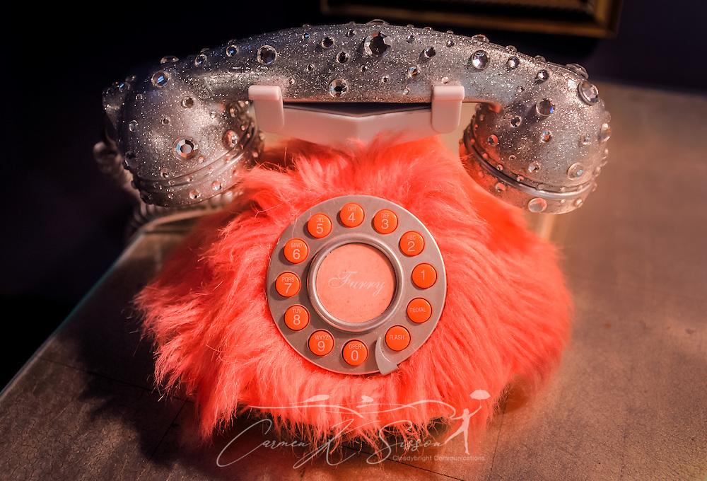 A pink telephone sits in the lobby at Elvis Presley's Heartbreak Hotel on Elvis Presley Boulevard in Memphis, Tennessee, Sept. 4, 2015. The telephone offers guests a direct line to the hotel's restaurant. Elvis Presley Enterpises purchased the hotel in 1999. A new $75 million hotel is expected to open in 2015, and the old hotel, located near Graceland, is slated for demolition. The hotel is named for the famous Presley song, which was released in 1956 and earned him his first gold record. (Photo by Carmen K. Sisson/Cloudybright)