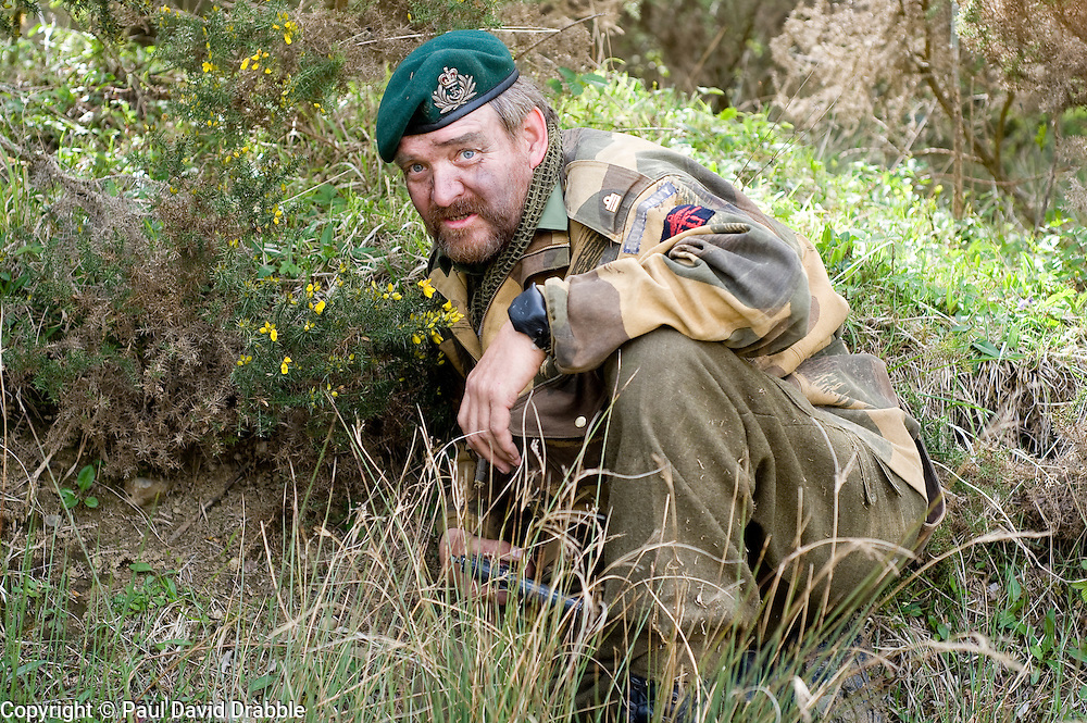 Reenactor from Northern World War Two Association, portraying a Royal Navy Commando, spots for a sniper during an ambush while taking part in a private 24hr excerise.<br /> Sutton Grange, near Ripon Yorkshire 15  May 2010 .Images &copy; Paul David Drabble.