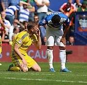 Matt Mills (Nottingham Forest defender) getting fouled by Massimo Luongo (QPR midfielder) during the Sky Bet Championship match between Queens Park Rangers and Nottingham Forest at the Loftus Road Stadium, London, England on 12 September 2015. Photo by Matthew Redman.