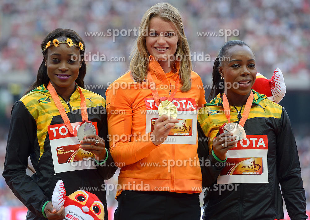 29-08-2015 CHN: IAAF World Championships Athletics day 7, Beijing<br /> Second placed Elaine Thompson (JAM), winner  Dafne Schippers (NED) and third placed Veronica Campbell-Brown (JAM) at medal ceremony of 200 m Women Photo by Ronald Hoogendoorn / Sportida