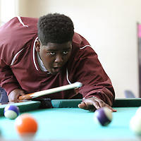 Ashton Story reacts as his shot just misses the target during a game of pool at the Northside Boys & Girls Club in Tupelo on Wednesday.