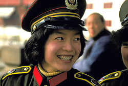 A beautiful, smiling Chinese soldier is seen on the streets of Beijing.