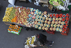 South Africa - Durban - 25 May 2020 - A man pushes a trolley loaded with bannanas, passing by a table with different kinds of fruits and veggies at the market in Warwick Avenue in Durban CBD<br /> Picture: Doctor Ngcobo/African News Agency(ANA)