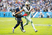 NASHVILLE, TN - DECEMBER 22:  Michael Thomas #13 of the New Orleans Saints runs a pass and stiff arms Logan Ryan #26 of the Tennessee Titans at Nissan Stadium on December 22, 2019 in Nashville, Tennessee. The Saints defeated the Titans 38-28.  (Photo by Wesley Hitt/Getty Images) *** Local Caption *** Michael Thomas; Logan Ryan