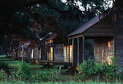 Slaves had to construct two-family cypress cabins at a proper distance from there masters mansion at Evergreen Plantation near New Orleans.