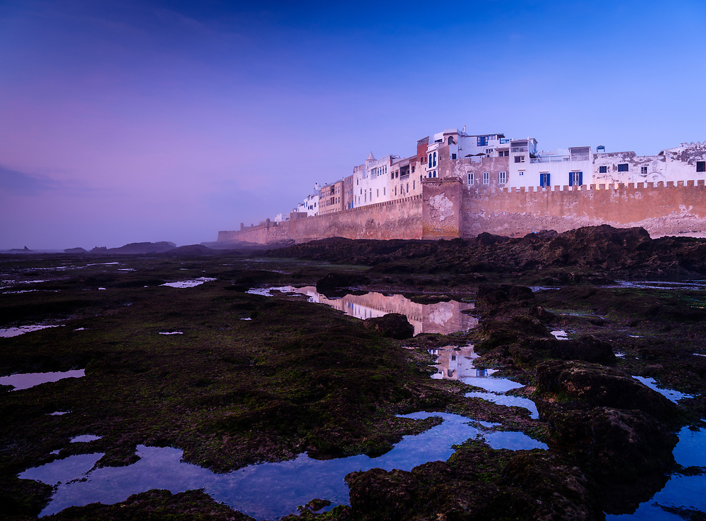 ESSAOURIA, MOROCCO - CIRCA MAY 2018:  View  of ESSAOUIRA, tidal pools and fortified walls at sunset.