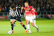 Grimsby Town forward Matt Green challenged by Salford City midfielder Lois Maynard  during the EFL Sky Bet League 2 match between Salford City and Grimsby Town FC at Moor Lane, Salford, United Kingdom on 17 September 2019.