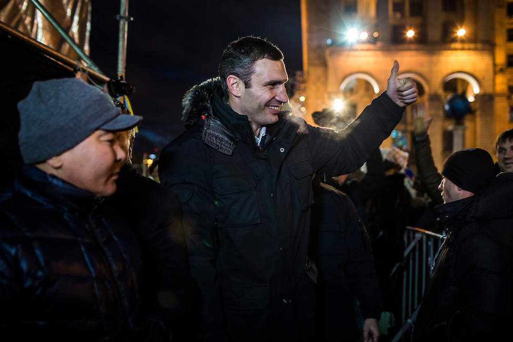KIEV, UKRAINE - DECEMBER 7: Vitali Klitschko, the reigning world heavyweight boxing champion and leader of opposition party the Ukrainian Democratic Alliance for Reform, gives a thumbs up to a supporter on Independence Square on December 7, 2013 in Kiev, Ukraine. Thousands of people have been protesting against the government since a decision by Ukrainian president Viktor Yanukovych to suspend a trade and partnership agreement with the European Union in favor of incentives from Russia. (Photo by Brendan Hoffman/Getty Images) *** Local Caption *** Vitali Klitschko