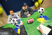 Media interviews Sarina Bolden and Jason Scrempos during the NCAA National Signing Day event at Milpitas High School in Milpitas, California, on February 4, 2015. (Stan Olszewski/SOSKIphoto)