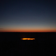 The Darwaza gas crater before dawn, with Venus in the sky, Karakum Desert, Turkmenistan