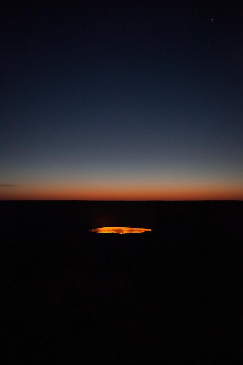 The Darwaza gas crater before dawn, with Venus in the sky, Karakum Desert, Turkmenistan