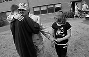 Specialist Frank Teta must say goodbye to his family again just hours after returning form Iraq. He hugs his son Mark, 14, and holds the hand of his daughter Rosemarie, 12, outside the barracks at Ft. Dix where he will remain until the rest of his demobilization.