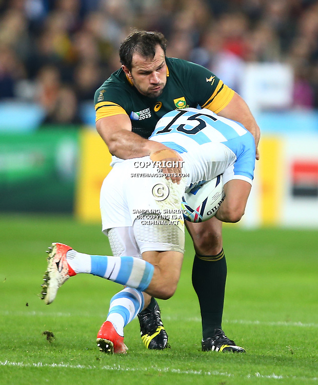 LONDON, ENGLAND - OCTOBER 30: Bismarck du Plessis of South Africa tackling Lucas Gonzalez Amorosino of Argentina during the Rugby World Cup 3rd Place Playoff match between South Africa and Argentina at Olympic Stadium on October 30, 2015 in London, England. (Photo by Steve Haag/Gallo Images)