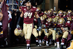 October 2, 2010; Chestnut Hill, MA, USA;  Boston College Eagles linebacker Mark Herzlich (94) leads his team on to the field before the game against the Notre Dame Fighting Irish at the Alumni Stadium.  Notre Dame defeated Boston College 31-13.