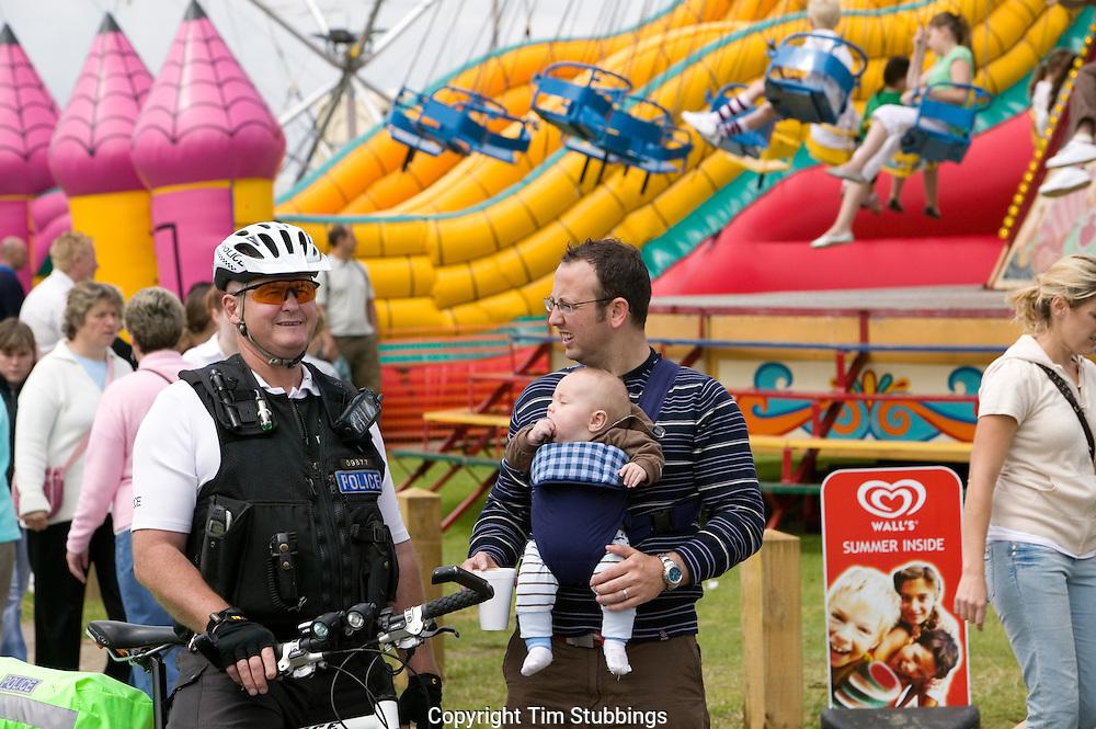 Policeman at Fun Fair on Tankerton Slopes, Whistable, Kent, England, UK