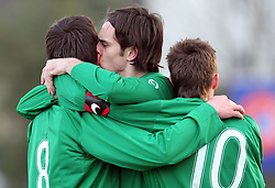 Armin Bacinovic (8) kissed by Matija Skarabot (3)  of Slovenia first goal during Friendly match between U-21 National teams of Slovenia and Romania, on February 11, 2009, in Nova Gorica, Slovenia. (Photo by Vid Ponikvar / Sportida)