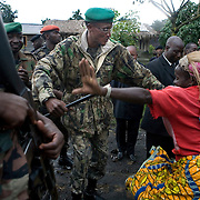 Laurent Nkunda, leader of the rebel group CNDP, the National Congress for the Defense of the People, dances with supporters after a  press conference in Kitchanga. The CNDP made several advances last week claiming a large swath of territory for the Congolese army.