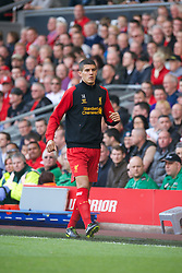 LIVERPOOL, ENGLAND - Sunday, May 19, 2013: Liverpool's substitute Conor Coady warms-up during the final Premiership match of the 2012/13 season against Queens Park Rangers at Anfield. (Pic by David Rawcliffe/Propaganda)