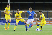 Peterborough United midfielder Chris Forrester (8) is surrounded by AFC Wimbledon defender Sean Kelly (22), AFC Wimbledon midfielder Dean Parrett (18), AFC Wimbledon striker Andy Barcham (17) during the EFL Cup match between Peterborough United and AFC Wimbledon at ABAX Stadium, Peterborough, England on 9 August 2016. Photo by Stuart Butcher.