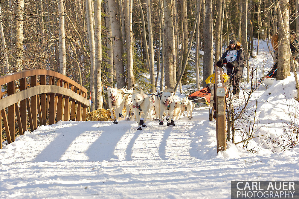 March 7th, 2009:  Anchorage, Alaska - Jim Lanier of Chugiak, Alaska brings his team across a foot bridge near Behm Lake during the 2009 Ceremonial Start to the Iditarod Sled Dog Race.