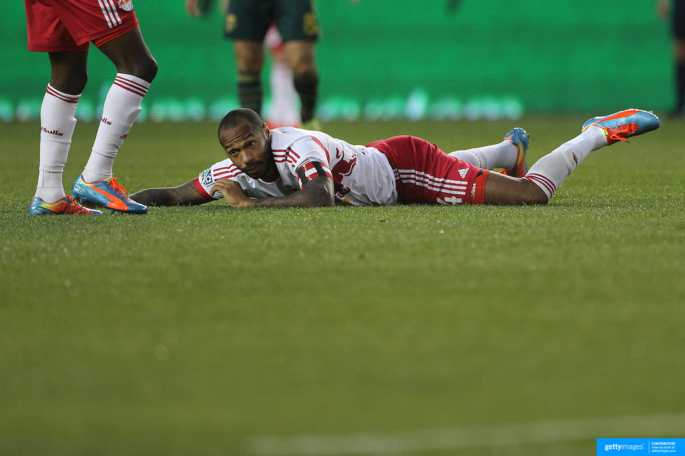 Thierry Henry. New York Red Bulls, on the ground after being fouled during the New York Red Bulls Vs Portland Timbers, Major League Soccer regular season match at Red Bull Arena, Harrison, New Jersey. USA. 24th May 2014. Photo Tim Clayton
