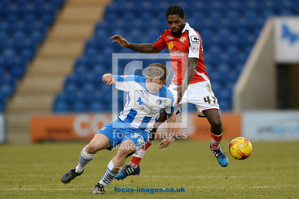 Tom Lapslie of Colchester United looks to get past Anthony Grant of Crewe Alexandra during the Sky Bet League 1 match between Colchester United and Crewe Alexandra at the Weston Homes Community Stadium, Colchester<br /> Picture by Richard Blaxall/Focus Images Ltd +44 7853 364624<br /> 07/02/2015