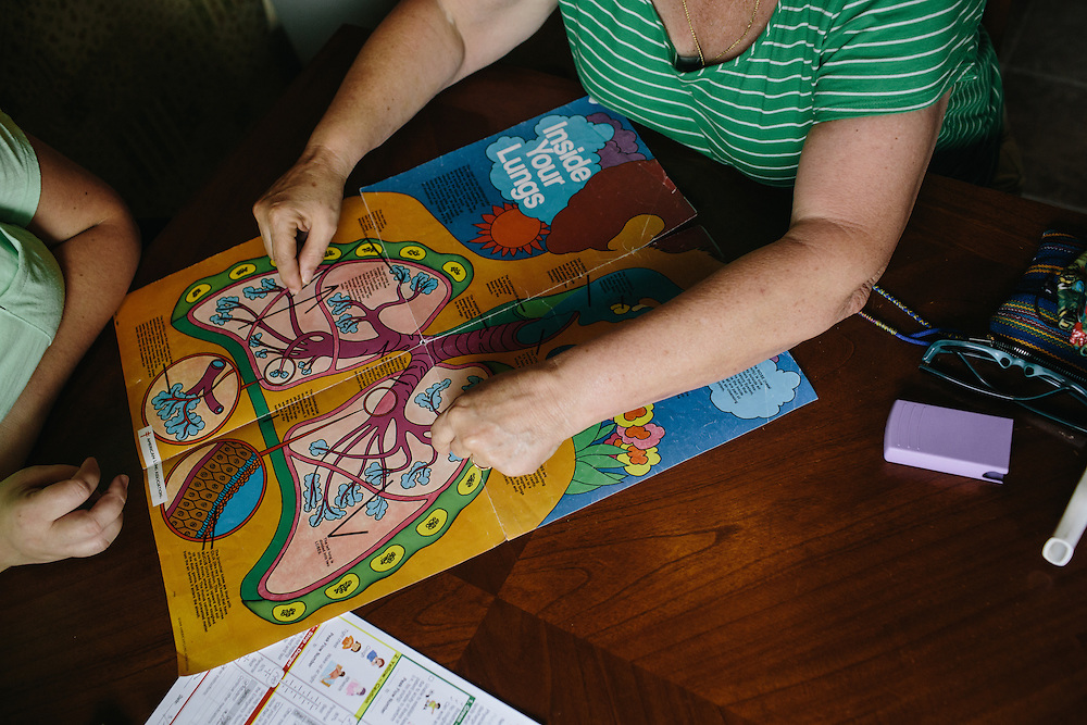 Asthma educator Sharon Borradori meets at the home of Amber Reese and her son Dylan Ivey, 7, in Bakersfield, California. Ivey recently was released from the hospital after being admitted for almost a week because of a severe asthma attack. Borradori runs a non-proft called Asthma and COPD Education Center. She makes visits to the hospitals and homes for free to help educate patients about asthma and how to control the disease.