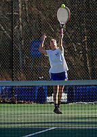 Gilford's Abby Lines serves to Danielle Bliss of Interlakes during their singles match Wednesday afternoon.  (Karen Bobotas/for the Laconia Daily Sun)