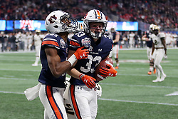 Auburn Tigers wide receiver Will Hastings (33) celebrates a touchdown during the 2018 Chick-fil-A Peach Bowl NCAA football game against the UCF Knights on Monday, January 1, 2018 in Atlanta. (Jason Parkhurst / Abell Images for the Chick-fil-A Peach Bowl)