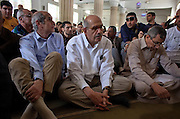 Egyptian Nobel Peace laureate and former UN atomic watchdog chief, Mohamed ElBaradei (C), sits for the start of Friday noon prayers at a small mosque in the Egyptian delta town of El Mansoura on April 2, 2010. ElBaradei is thought to be a possible candidate to run against Egyptian President Hosni Mubarak in the 2011 presidential election, although he has not made a formal declaration as of yet.