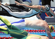 New Zealand's Moss Burmester in action on his way to winning a Bronze medal in the Mens 100m Butterfly Swimming Final at the XVIII Commonwealth Games, Melbourne, Australia, Monday, March 20 2006. Photo: Michael Bradley/PHOTOSPORT<br /><br />150609 dive race start