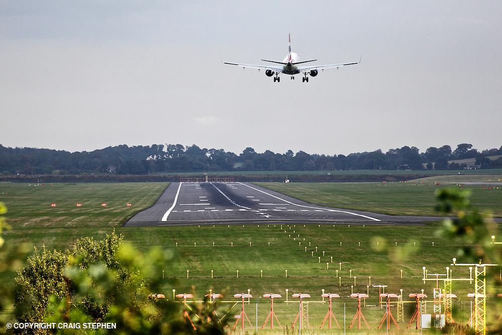 A plane landing at Edinburgh airport, Scotland, UK