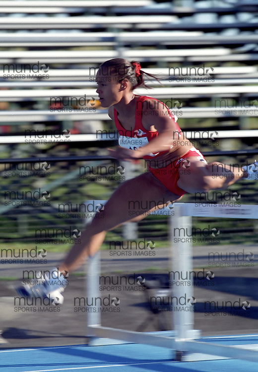 (Ottawa, Ontario---21 July 2001)  Leslie Tashlin competing in the 100m hurdles at the 2001 Jeux de la Francophonie (Francophone Games). Copyright Sean Burges / Mundo Sport Images, 2001