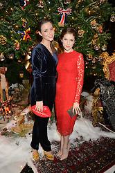 Left to right, KELLY EASTWOOD and ANNA KENDRICK at a party to celebrate the unveiling of the 2014 Claridge's Christmas tree by Dolce & Gabbana at Claridge's, Brook Street, London on 19th November 2014.