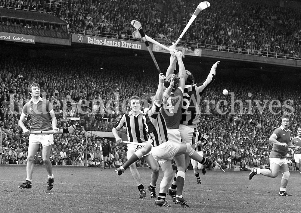 978-153<br /> Watched by Sean O'Leary (15, Cork) and Paddy Prendergast (2, Kilkenny), Noel Skehan the Kilkenny keeper, makes another fine save.<br /> (Part of the Independent Newspapers Ireland/NLI collection.)