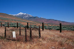 &quot;Gravesite in Unionville, Nevada&quot; - Unionville was once a busy mining town off the now Hwy 400. Star Peak can be seen in the distance. <br />